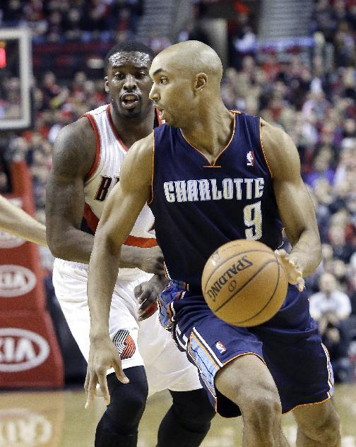 Charlotte Bobcats guard Gerald Henderson, right, drives past Portland Trails Blazers guard Wesley Matthews during the first half of an NBA basketball game in Portland, Ore., Thursday, Jan. 2, 2014
