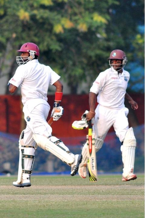 West Indies player N Deonarine and S Chanderpaul in action during Day one of practice match between West Indies and Uttar Pradesh Cricket Association XI at the Jadavpur University Ground in Kolkata on