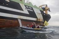 Image provided by Greenpeace shows activists on an inflatable boat blocking Dutch super-trawler FV Margiris' attempt to enter Port Lincoln in South Australia on August 30. The trawler's operators would have to prove they were doing everything necessary to minimise by-catch