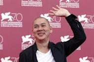 "Director Tsai Ming-Liang, poses during a photocall for the movie ""Stray Dogs"", directed by him, during the 70th Venice Film Festival in Venice September 5, 2013. REUTERS/Alessandro Bianchi"