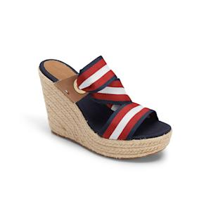 This product image released by Tommy Hilfiger shows a red, white and blue canvas slingback wedge. The rope-soled shoes have long been a staple of the fair-weather seasons, no matter if there's a chill in the air or the sidewalks are steaming. It's all good as long as the sun is shining. (AP Photo/Tommy hilfiger)