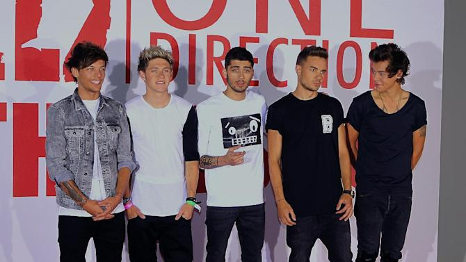 One Direction, from left to right, Louis Tomlinson, Niall Horan, Zayn Malik, Liam Payne and Harry Styles, at a photocall to promote the film, This Is Us, at the Sky Studios, London, Monday Aug. 19, 2013. The film is an intimate all-access look at life on the road for the global music phenomenon. (Photo by Jon Furniss Photography/Invision/AP)