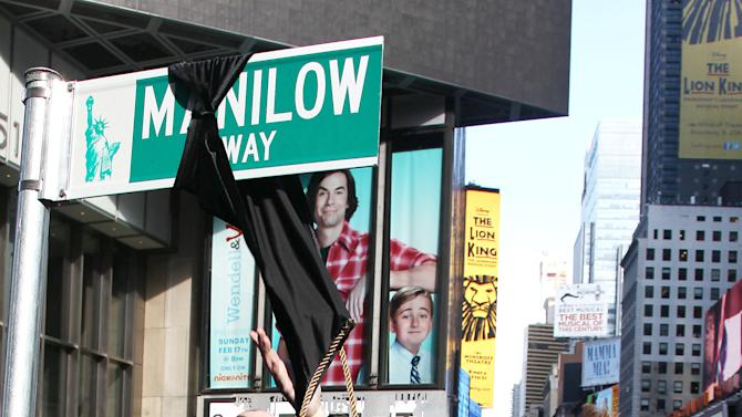 "This image released by Starpix shows Barry Manilow unveiling a street sign reading Manilow Way in Times Square, Tuesday, Jan. 22, 2013 in New York. Manilow is performing in ""Manilow on Broadway,"" until Feb. 23 at the St. James Theatre. (AP Photo/Starpix, Kristina Bumphrey)"
