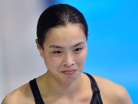 China's Wu Minxia smiles after winning the gold medal during the women's 3m springboard final at the London 2012 Olympic Games at the Aquatics Centre
