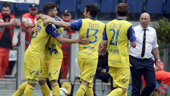 Chievo Verona's Paloschi celebrates with teammates after scoring against Lazio during their Serie A soccer match at the Olympic stadium in Rome