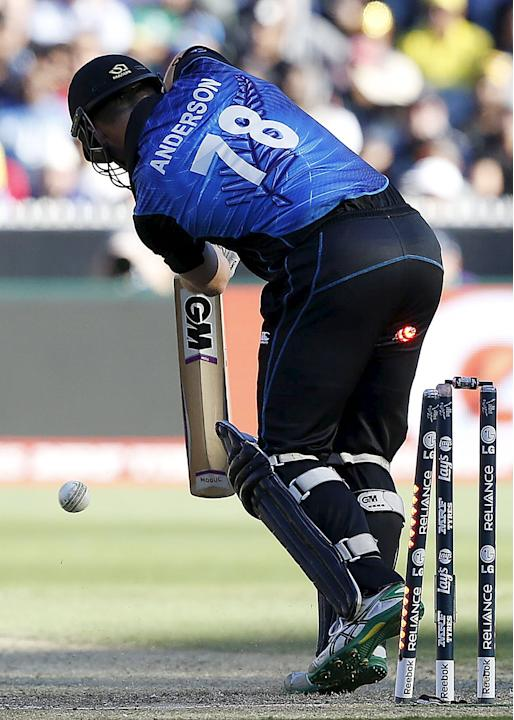 New Zealand's Corey Anderson is bowled by Australia's James Faulkner for a duck during their Cricket World Cup final match at the MCG