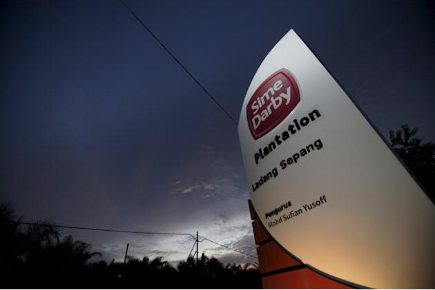 File photo of Sime Darby logo on display at entrance to its plantation outside Kuala Lumpur