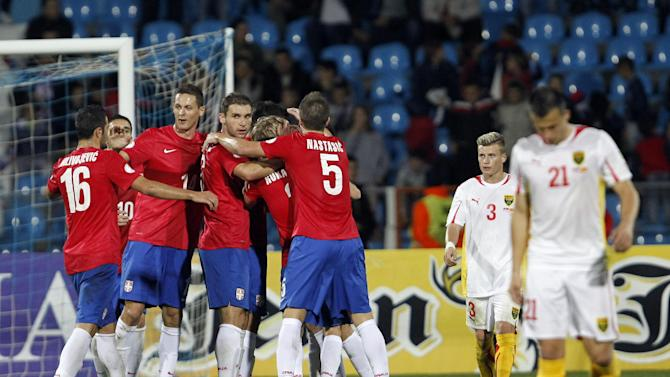 Serbian players celebrate during their World Cup 2014 Group A qualifying soccer match against Macedonia, at the City Stadium in Jagodina, Serbia, Tuesday, Oct. 15, 2013