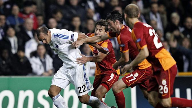 Galatasaray AS's Aydin Yilmaz, second left, Albert Riera, third left, and Semih Kaya, right, tries to stop FC Copenhagen's Daniel Braaten of Norway during their Champions League Group B soccer match at Parken Stadium, Copenhagen, Denmark, Tuesday Nov. 5, 2013