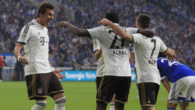 Bayern's Mario Mandzukic of Croatia, left, celebrates with teammates after scoring during the German first division Bundesliga soccer match between Schalke 04 and Bayern Munich in Gelsenkirchen, Germany, Saturday, Sept. 21, 2013