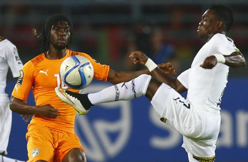 Ivory Coast's Gervinho challenges Ghana's Christian Atsu during the African Nations Cup final soccer match in Bata