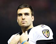 Joe Flacco of the Baltimore Ravens looks on from the field during a power outage while playing against the San Francisco 49ers during Super Bowl XLVII at the Mercedes-Benz Superdome on February 3, 2013 in New Orleans, Louisiana. Flacco signed the richest contract in National Football League history Monday, a six-year deal worth $120.6 million to stay with the Super Bowl champions