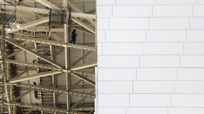 A labourer works at the site of the Arena Corinthians stadium in Sao Paulo