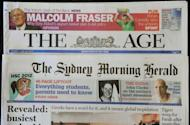 "The front pages of Australian media giant Fairfax's newspapers ""The Age"" (top) and ""The Sydney Morning Herald"" (below) are displayed in Sydney on June 18, 2012. A shakeup which will see Australia become the first country in the world with all its flagship newspapers behind an Internet paywall has prompted declarations that the ""golden age of newspapers is dead"""