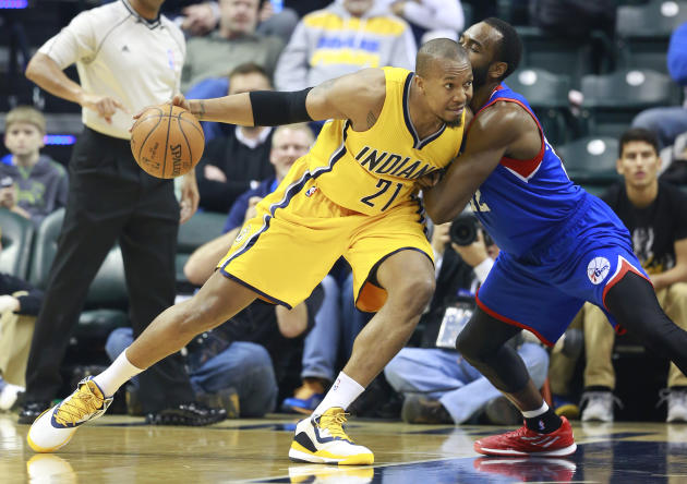 FILE - In this March 1, 2015, file photo, Indiana Pacers forward David West, left, moves to the basket defended by Philadelphia 76ers forward Luc Mbah a Moute in the first half of an NBA basketball ga