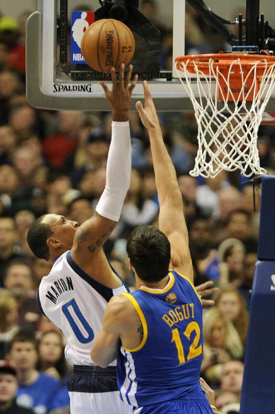 Dallas Mavericks small forward Shawn Marion (0) goes to the basket over Golden State Warriors center Andrew Bogut (12) in the first half during an NBA basketball game on Wednesday, Nov. 27, 2013 in Dallas