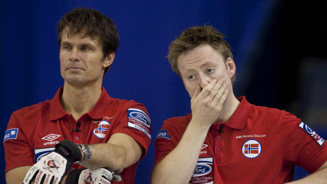 Norwegian skip Thomas Ulsrud (L) and third Torger Nergaard react to a missed shot in their 7-6 loss to Sweden in the bronze medal match at the Ford World Men's Curling Championships in Regina, Saskatchewan, April 10, 2011.   AFP PHOTO / Geoff Robins (Photo credit should read GEOFF ROBINS/AFP/Getty Images)