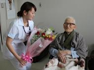Jiroemon Kimura receives a flower bouquet on his birthday in 2012 at a hospital in Kyotango, Kyoto. Kimura turned 116 on Friday as local health chiefs in Japan launch a study to find out why he and many of those around him have lived so long