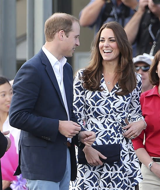 Britain's Kate, the Duchess of Cambridge smiles as she looks at her husband Prince William as they arrive at Echo Point Lookout in Katoomba, Australia, Thursday, April 17, 2014. The Duke and Duche