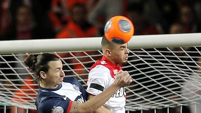 Paris Saint Germain's Zlatan Ibrahimovic of Sweden, left, jumps for the ball with Monaco's Layvin Kurzawa of France during their French League One soccer match, in Monaco stadium, Sunday, Feb. 9 , 2014