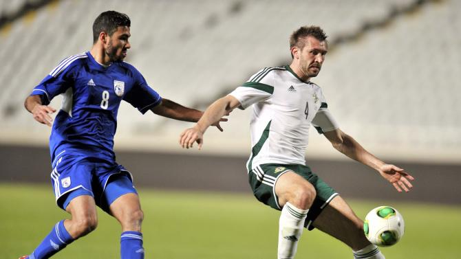 Northern Ireland's McAuley is challenged by Cyprus' Mytidis during their international friendly match at Gsp Stadium