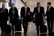 Former New Mexico governor Bill Richardson (2nd R) and Google chairman Eric Schmidt (C) arrive at Beijing airport from North Korea, on January 10, 2013. Richardson and Schmidt met with reporters following their visit to the secretive state calling for greater Internet freedom for the welfare of its people