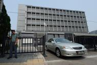 A vehicle leaves the Japanese embassy in Beijing on August 28. Japan's foreign minister Tuesday said it was time to address relations with China which have soured over a territorial dispute as an incident targeting the Japanese ambassador added to tensions