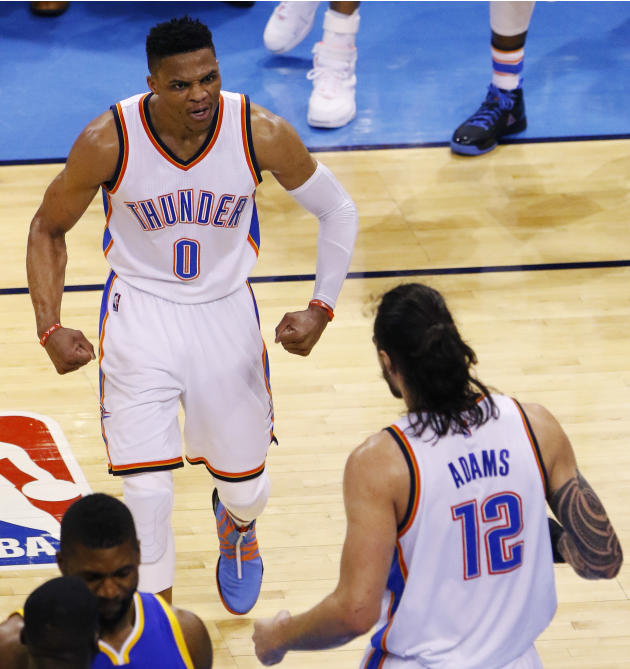 Oklahoma City Thunder guard Russell Westbrook (0) and center Steven Adams (12) celebrate against the Golden State Warriors during the second half in Game 6 of the NBA basketball Western Conference Fin
