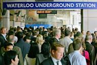 Passengers jostling to enter Waterloo underground station in central London. London's roads and ageing underground train network are already overcrowded, and many doubt fans, athletes, officials and journalists will be able to get to the Olympics without bringing the rest of the capital grinding to a halt