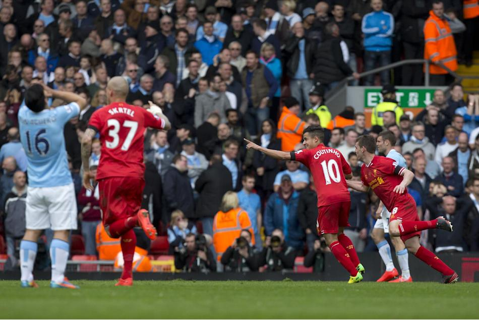 Liverpool's Philippe Coutinho, second right, celebrates after scoring the winning goal against Manchester City during their English Premier League soccer match at Anfield Stadium, Liverpool, Engla