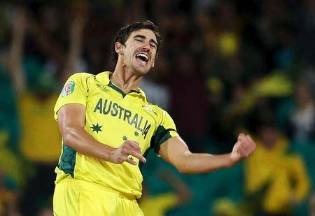 Australia's Mitchell Starc celebrates after India's Umesh Yadav was bowled out during their Cricket World Cup semi-final match in Sydney