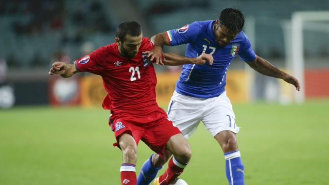Azerbaijan's Dashdemirov  fights for ball with Italy's Eder during their Euro 2016 group H qualifying soccer match at Olympic Stadium in Baku