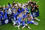 Chelsea players celebrate with the trophy after the UEFA Champions League final. Chelsea beat Bayern Munich 4-3 on penalties to win the Champions League