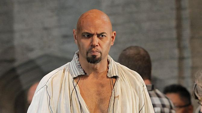 "In this September 2011 photo provided by the Metropolitan Opera, Keith Miller plays Lord Rochefort in Donizetti's ""Anna Bolena,"" at the Metropolitan Opera in New York. The former University of Colorado fullback has reinvented himself, going from the gridiron to the stage and will appear in Verdi's ""Un Ballo in Maschera,"" at the Metropolitan Opera. Performances begin Thursday, Nov. 8, 2012. (AP Photo/Metropolitan Opera, Ken Howard)"