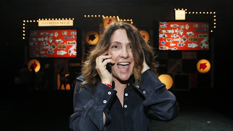 "Director Jill Soloway celebrates as she talks to her son Isaac on the phone after winning the U.S. Dramatic Directing Award for the film ""Afternoon Delight"" during the 2013 Sundance Film Festival Awards Ceremony on Saturday, Jan. 26, 2013 in Park City, Utah. (Photo by Danny Moloshok/Invision/AP)"