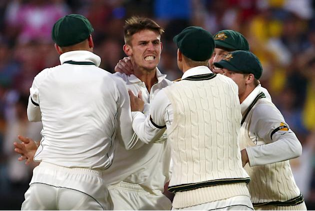 Australia's Mitchell Marsh celebrates with team mates after he dismissed New Zealand's Kane Williamson for nine runs during the second day of the third cricket test match at the Adelaide Oval,