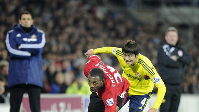 Cardiff City's Theophile-Catherine is challenged by Sunderland's Ki during their English Premier League soccer match in Cardiff