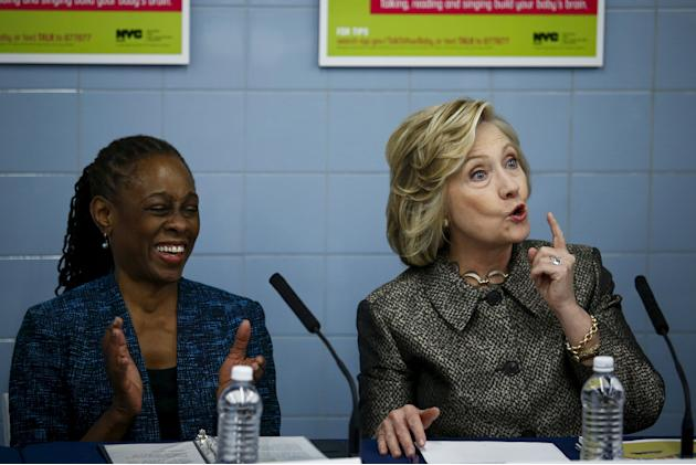 """Former U.S. Secretary of State Hillary speaks to guests next to  New York first Lady McCray while they attend the early childhood development initiative """"talk to you baby"""" in Brooklyn, New Y"""