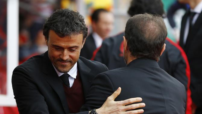 Barcelona coach Enrique greets Granada coach Resino before the start of their Spanish First Division soccer match at Nuevo Los Carmenes stadium in Granada