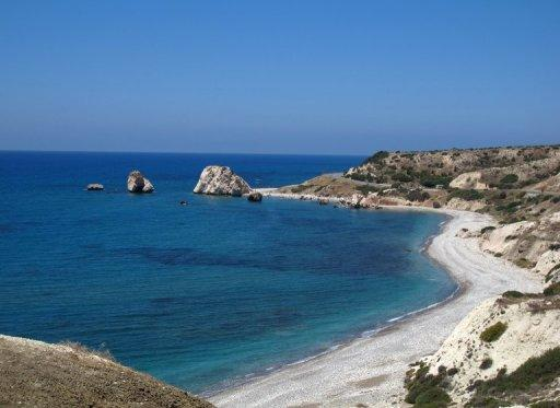 Petra Tou Romiou (Aphrodite's Rock) is pictured in southwestern Cyprus in June 2012. Credit rating agency Moody's cut the debt ratings for Cyprus and three Cypriot banks Monday, saying it expected the government to have to rescue the troubled banks with outside support.