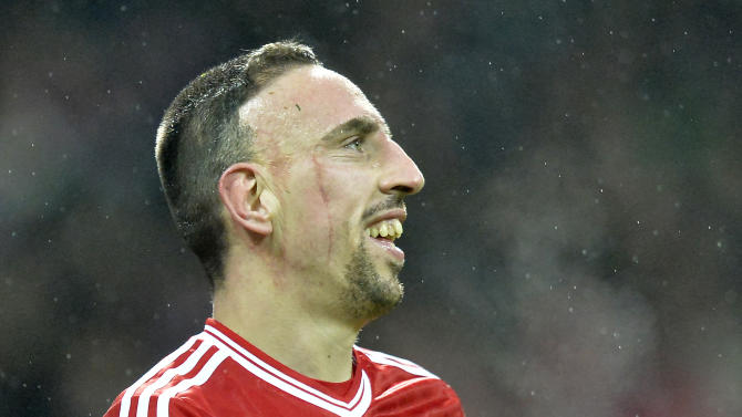 Bayern's thre- times scorer Franck Ribery of France smiles  during the German Bundesliga soccer match between Werder Bremen and Bayern Munich in Bremen, Germany, Saturday, Dec. 7, 2013. Bayern defeated Bremen by 7-0