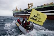 Image provided by Greenpeace shows activists on an inflatable boat blocking Dutch super-trawler FV Margiris' attempt to enter Port Lincoln in South Australia on August 30. The trawler was Tuesday given the go-ahead to fish in Australian waters but with tough conditions to minimise by-catch such as dolphins, seals and sea lions