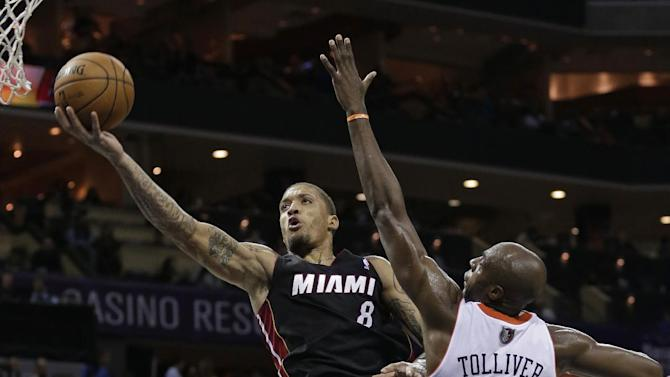 Miami Heat's Michael Beasley (8) drives past Charlotte Bobcats' Anthony Tolliver (43) during the second half of an NBA basketball game in Charlotte, N.C., Saturday, Nov. 16, 2013. Miami won 97-81