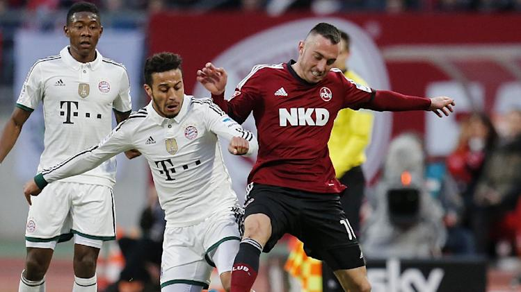 Nuremberg's Josip Drmic of Switzerland, right, and Bayern's Thiago Alcantara of Spain challenge for the ball during a   German first  division  soccer match between 1.FC Nuremberg and Bayern Munich in Nuremberg, Germany, Saturday, Feb. 8, 2014