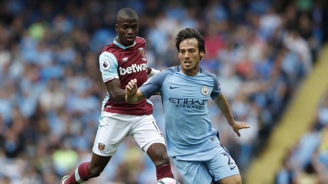 Manchester City's David Silva in action with West Ham United's Enner Valencia