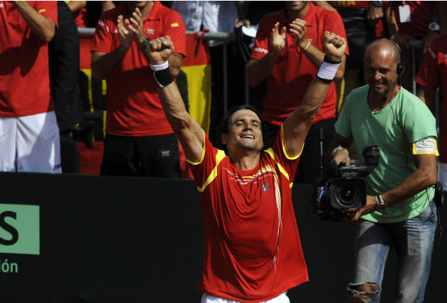 David Ferrer of Spain celebrates after beating John Isner of the U.S. during the Davis Cup World Group semi-final match in Gijon