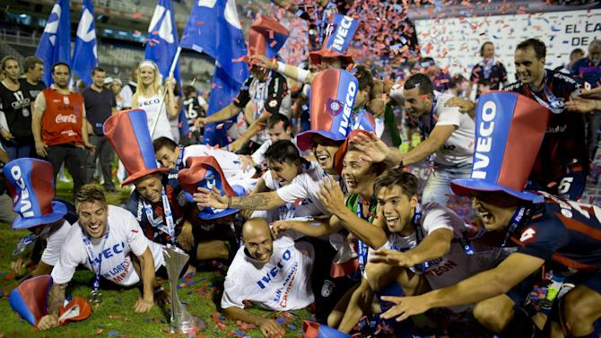 San Lorenzo's player celebrate after defeating Velez Sarsfield during the final match of the Argentine soccer league championship in Buenos Aires, Argentina,  Sunday, Dec. 15, 2013