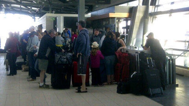 Passengers of a Sunwing flight to Varadero, Cuba, wait at the Ottawa airport Friday morning for a possible second flight after their plane was forced to make an emergency landing when white, odourless smoke filled the cabin.