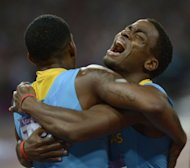 Bahamas' Michael Mathieu (R) and Demetrius Pinder celebrate after winning gold in the men's 4 x 400m relay final at the athletics event of the London 2012 Olympic Games on August 10, 2012 in London