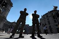 British soldiers guard the entrance to Horseguards, venue for the beach volleyball competition, in London on July 24. Britain has drafted in another 1,200 troops to plug a security gap at the London Olympics left by the failure of a private security firm to provide enough guards